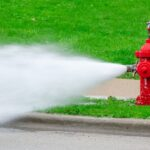 Red fire hydrant with high pressure water spray